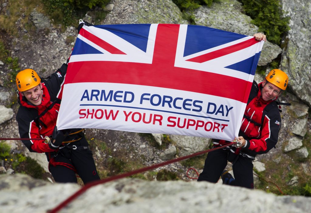Armed Forces Day flag held by two abseilers